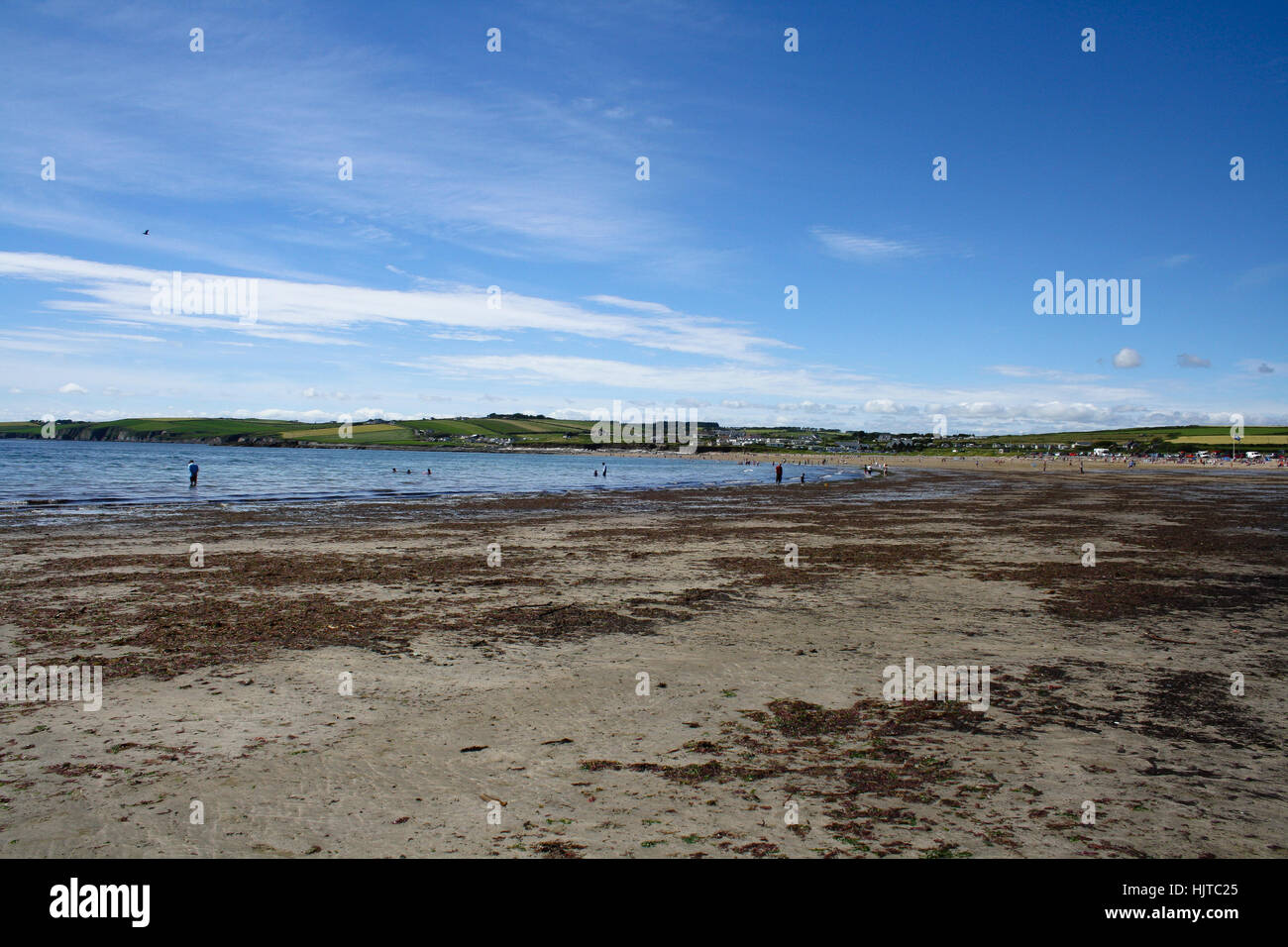 July 27, 2012, Myrtleville, Ireland. People enjoying a rare sunny Irish summer day on the Myrtleville beach. - Stock Image