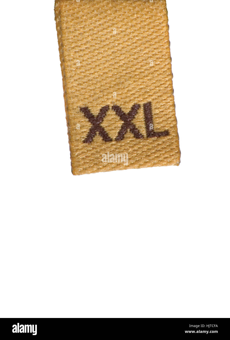 Macro XXL size clothing label tag, isolated closeup, beige, brown Stock Photo