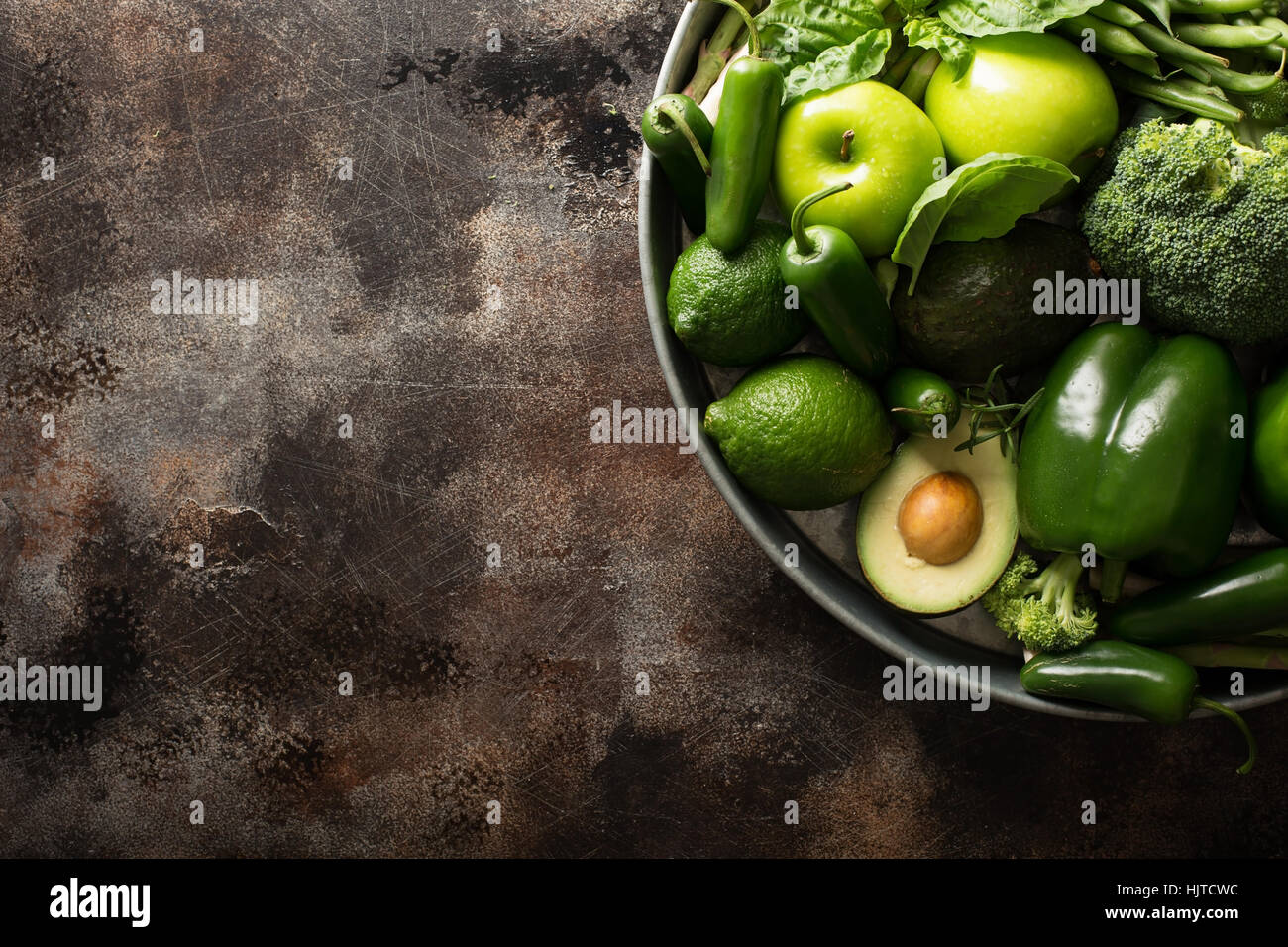 Variety of green vegetables and fruits - Stock Image