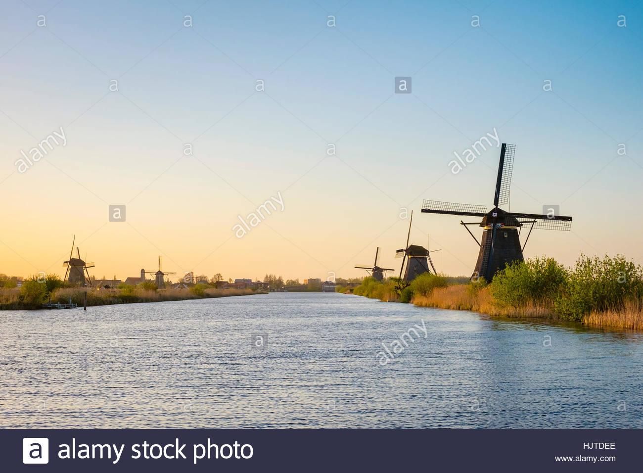 Netherlands, South Holland, Kinderdijk, UNESCO World Heritage Site. Historic Dutch windmills on the polders at sunset. Stock Photo