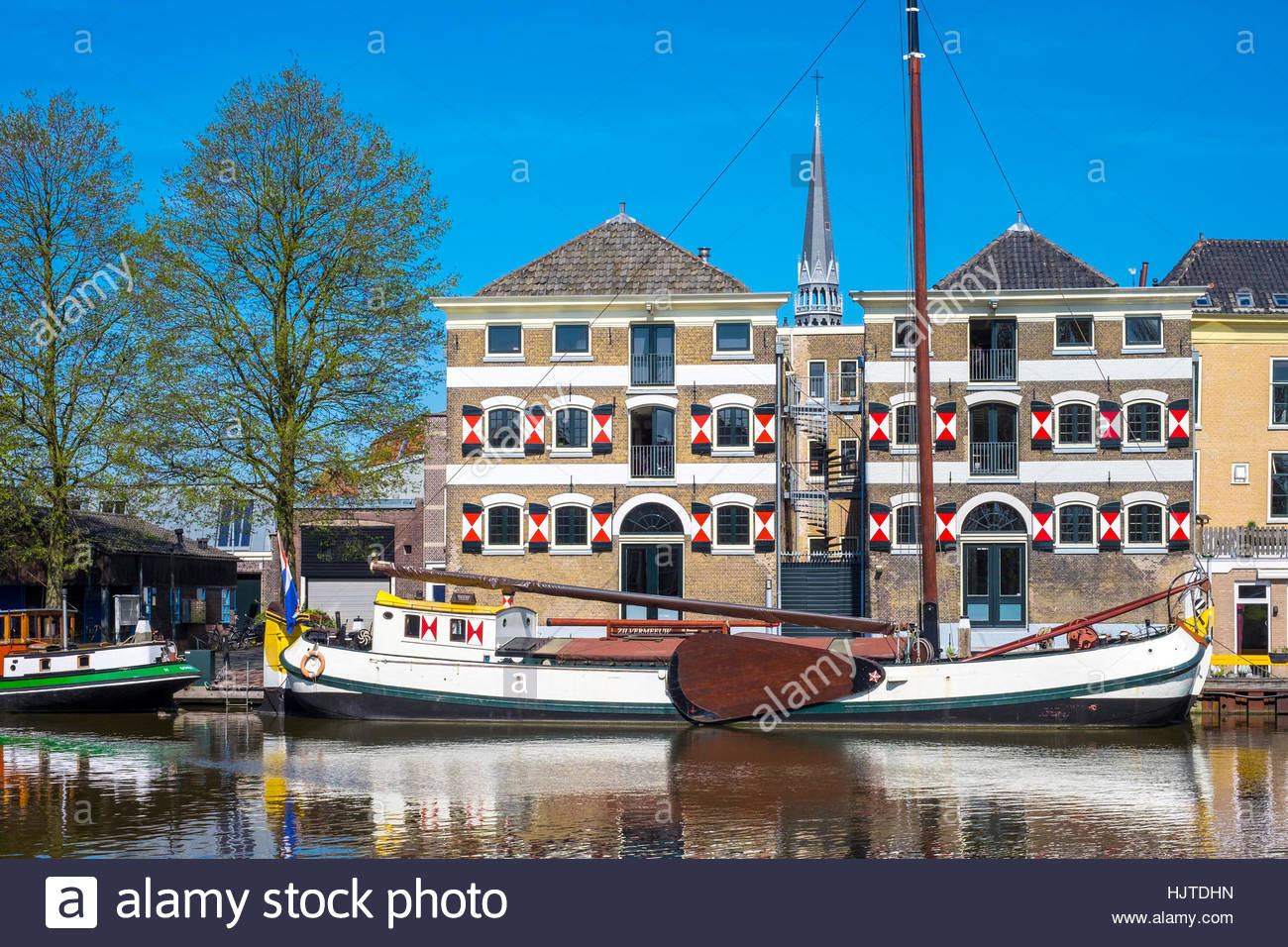 Netherlands, South Holland, Gouda. Historic ships and buildings on Binnenhavenmuseum Gouda harbor museum. Stock Photo
