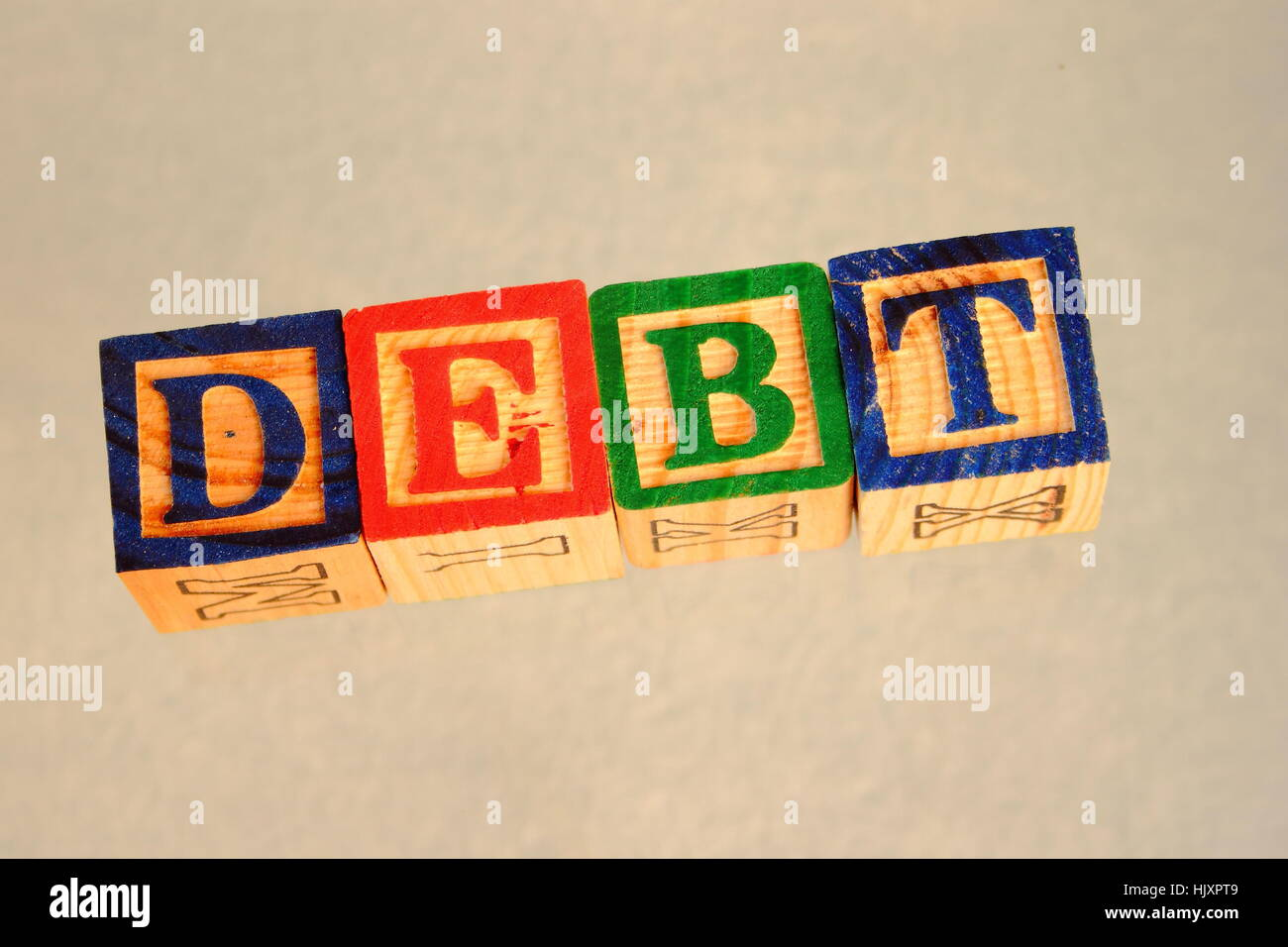 Business term debt visually displayed on a light background image with copy space in landscape format - Stock Image