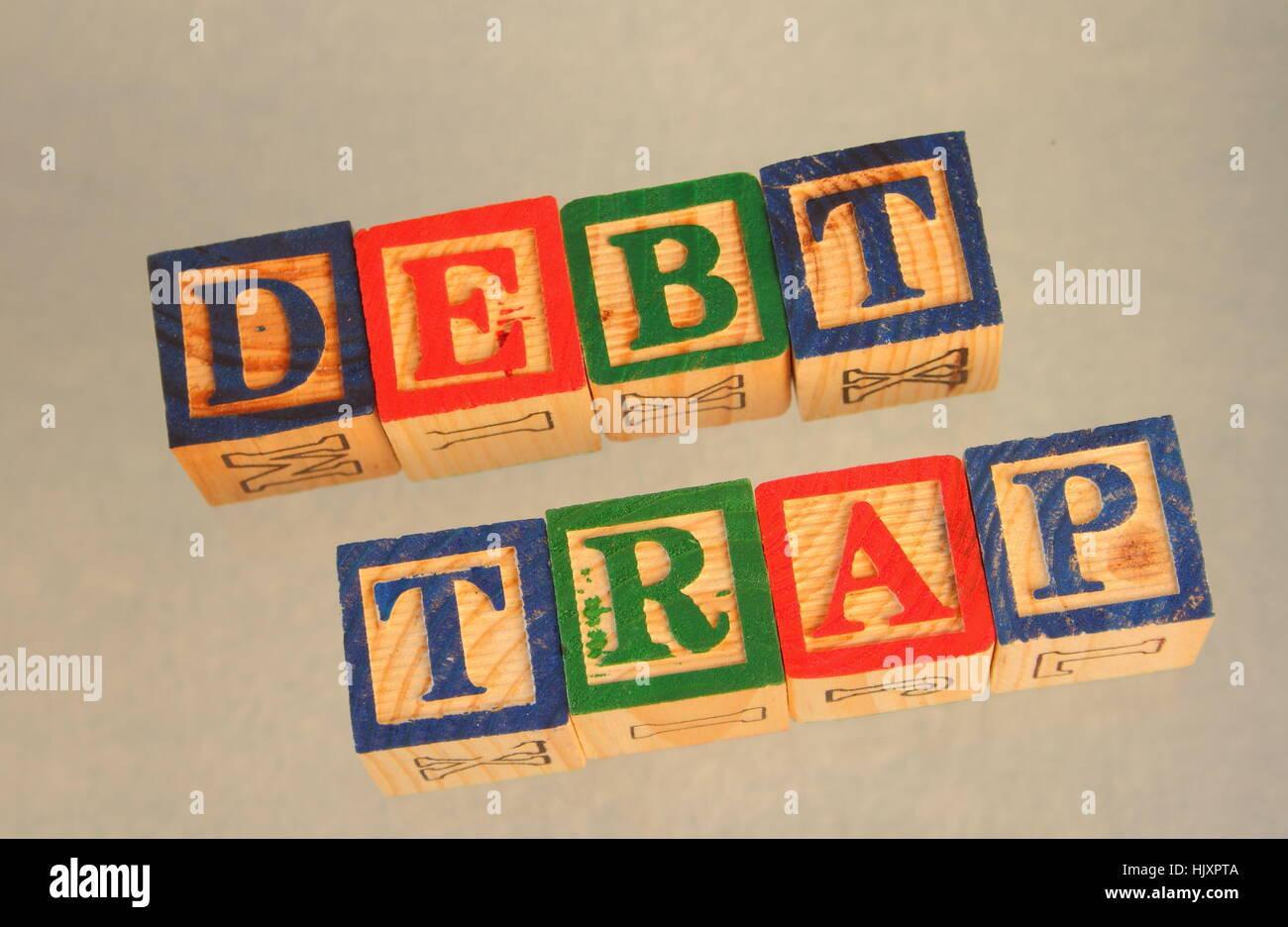 Business term - debt trap - visually displayed on a white background in landscape format - Stock Image