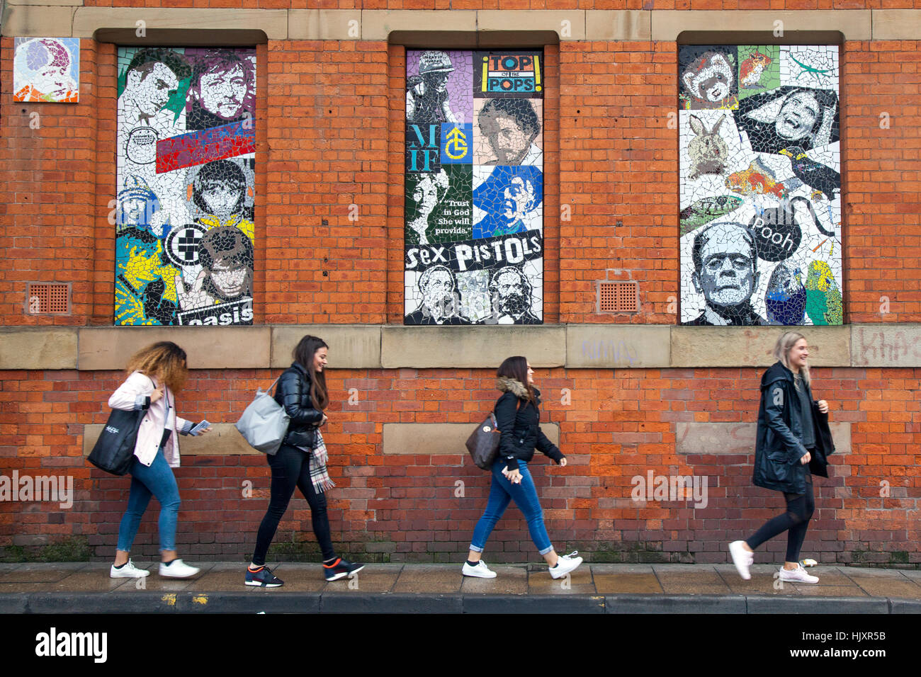 Mosiacs & faces of famous icons in Tib Street, Northern Quarter, Manchester, UK - Stock Image