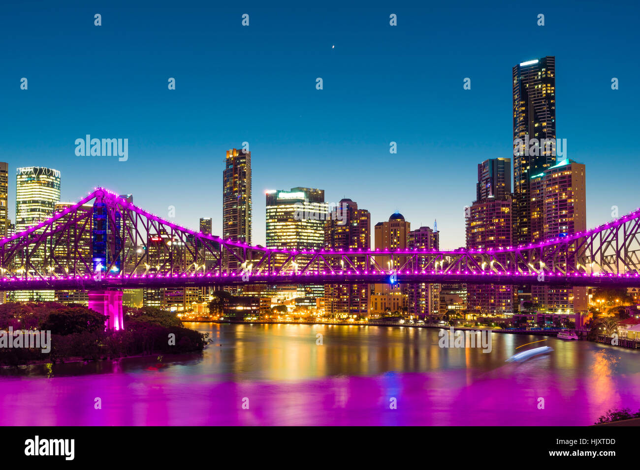 Bridge and skyscrapers in Brisbane at twilight - Stock Image