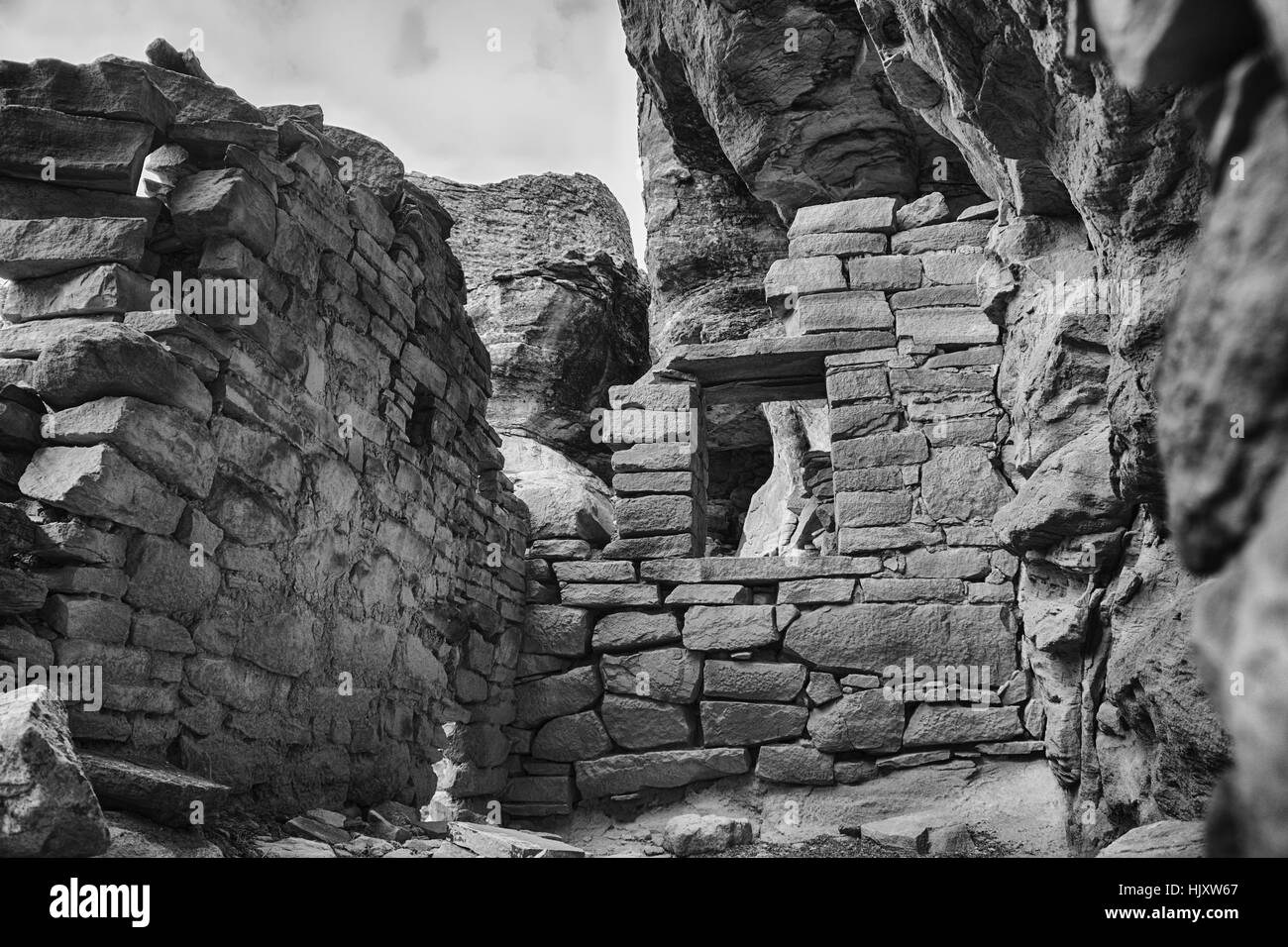 Looking into the remains of an Ancestral Puebloan room. Part of an ancient Anasazi pueblo. A  black and white photo. - Stock Image