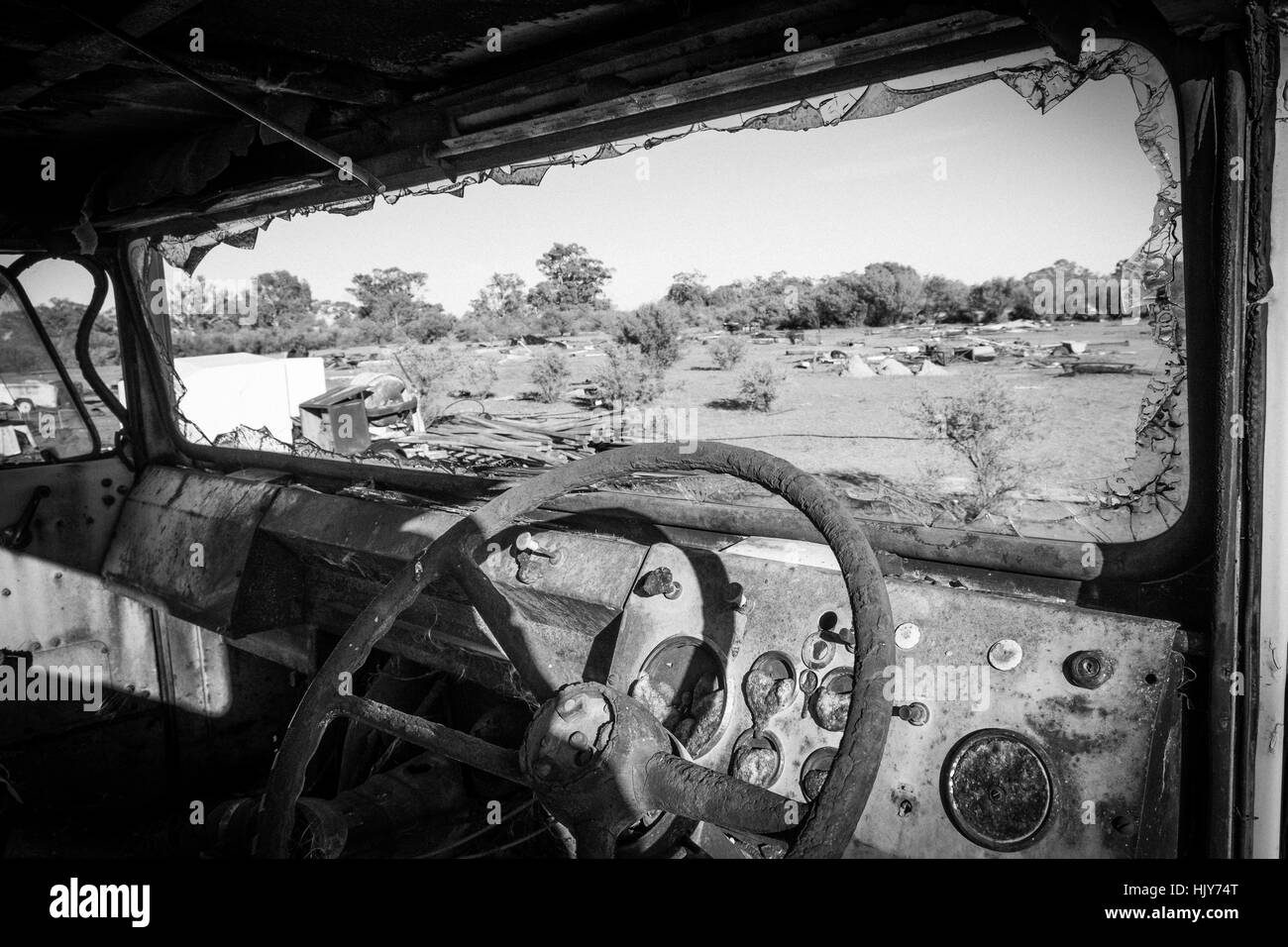 View through the windscreen of an abandoned truck onto a desert wasteland in outback New South Wales, Australia - Stock Image