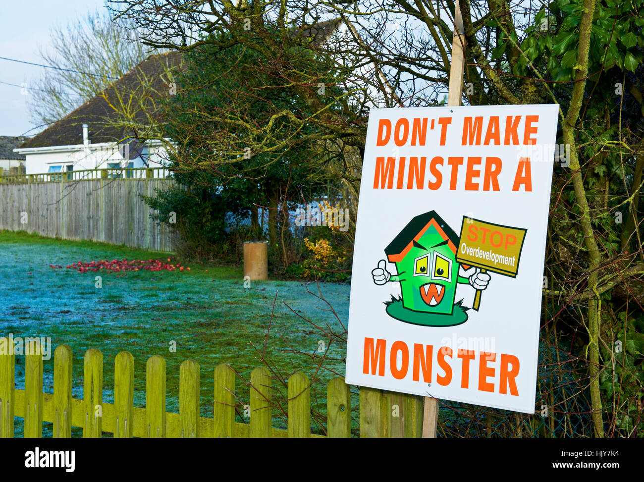 Sign protesting about building plans - Don't Make Minster a Monster - Minster Lovell, Oxfordshire, England UK - Stock Image