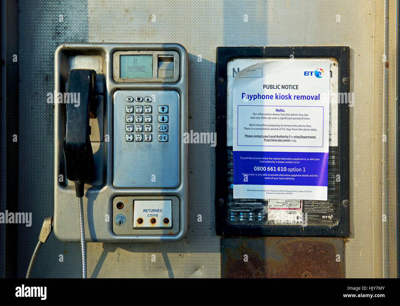 Payphone with notice announcing removal, England UK - Stock Image