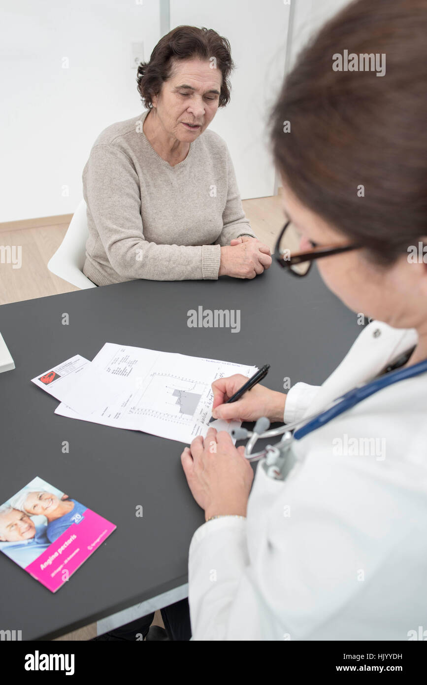 Senior female patient consults cardiologist Stock Photo