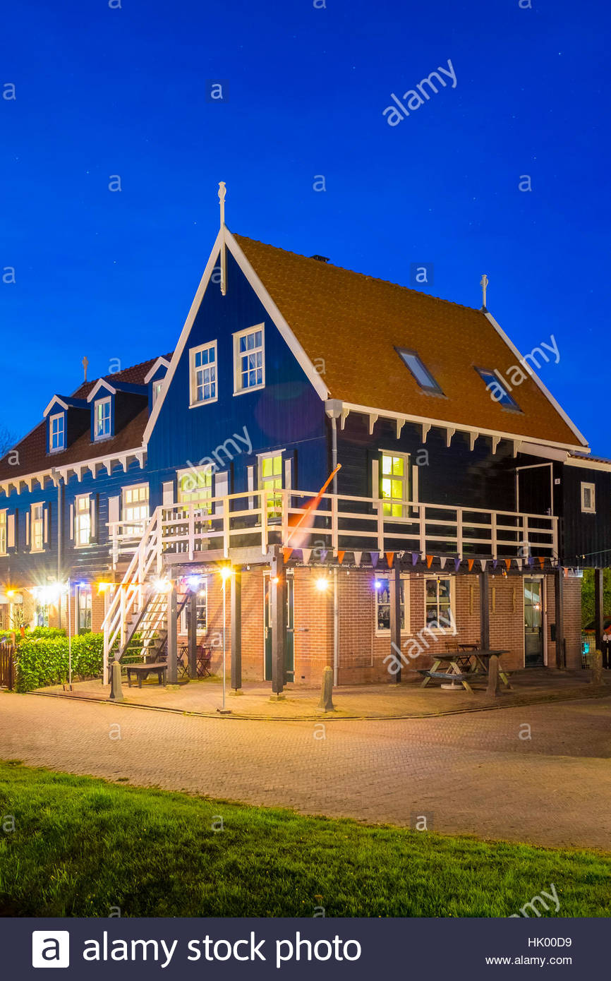 Netherlands, North Holland, Marken. Traditional wooden house in Havenbuurt, decorated with lights for Koningsdag - Stock Image
