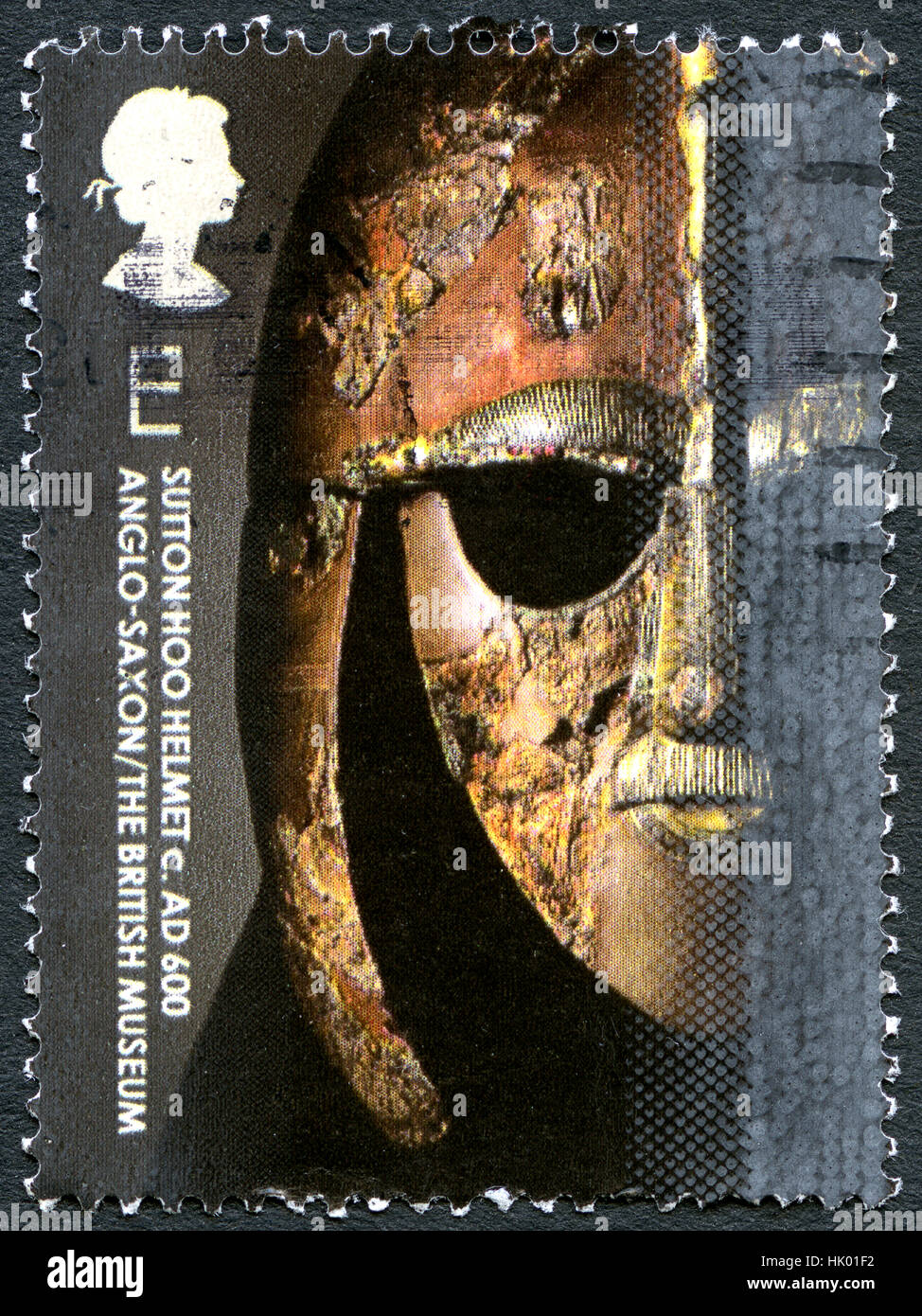 GREAT BRITAIN - CIRCA 2003: A used postage stamp from the UK, depicting an image of a Sutton Hoo Helmet exhibited - Stock Image