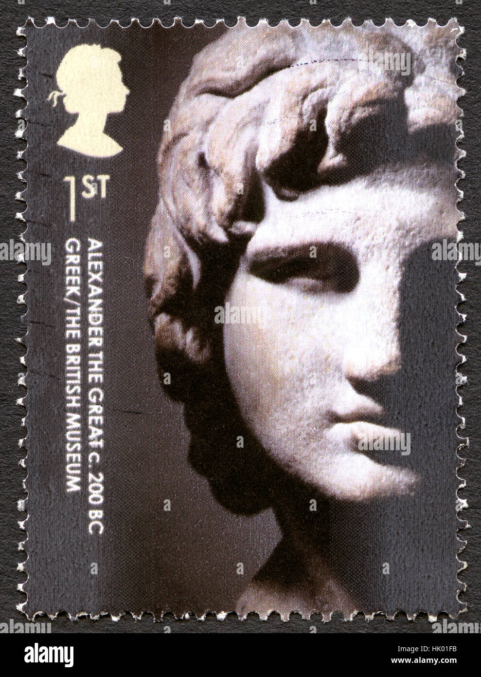 GREAT BRITAIN - CIRCA 2003: A used postage stamp from the UK, depicting an image of an Alexander the Great sculpture - Stock Image