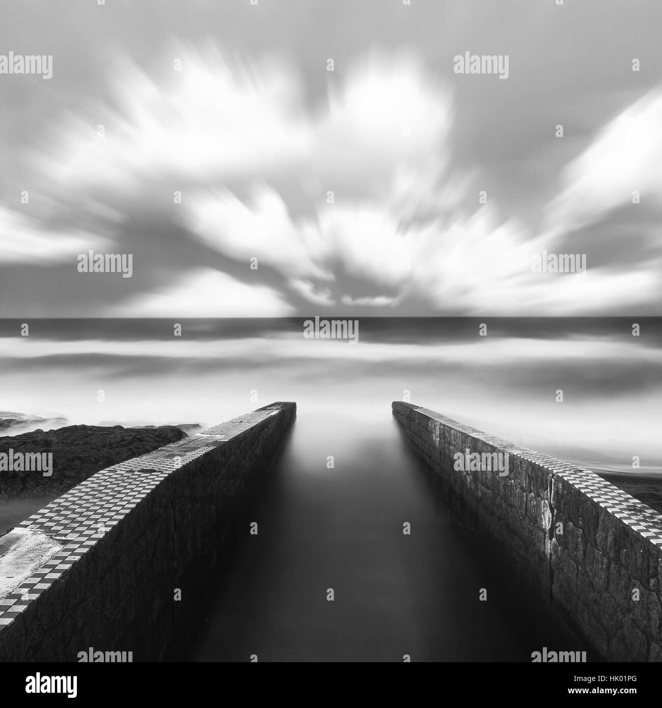 Silky water and clouds by a pier in Inamuragasaki, Kanagawa Prefecture, Japan - Stock Image