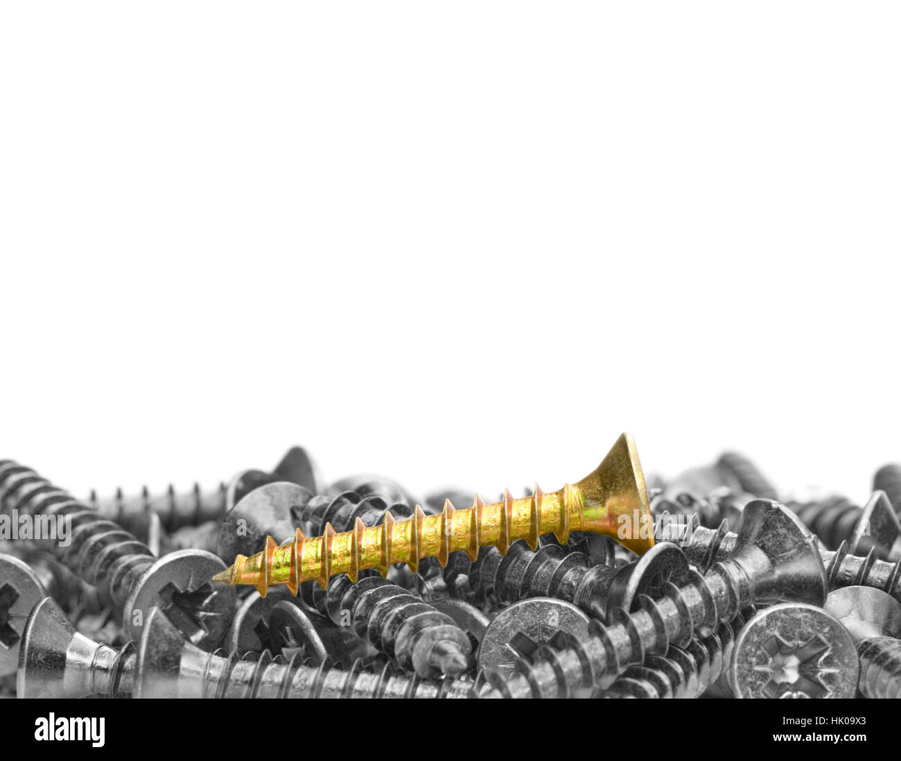 Many black and white screws and one color screw on a white background