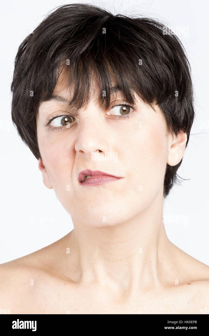 Portrait of brown woman grimacing - Stock Image