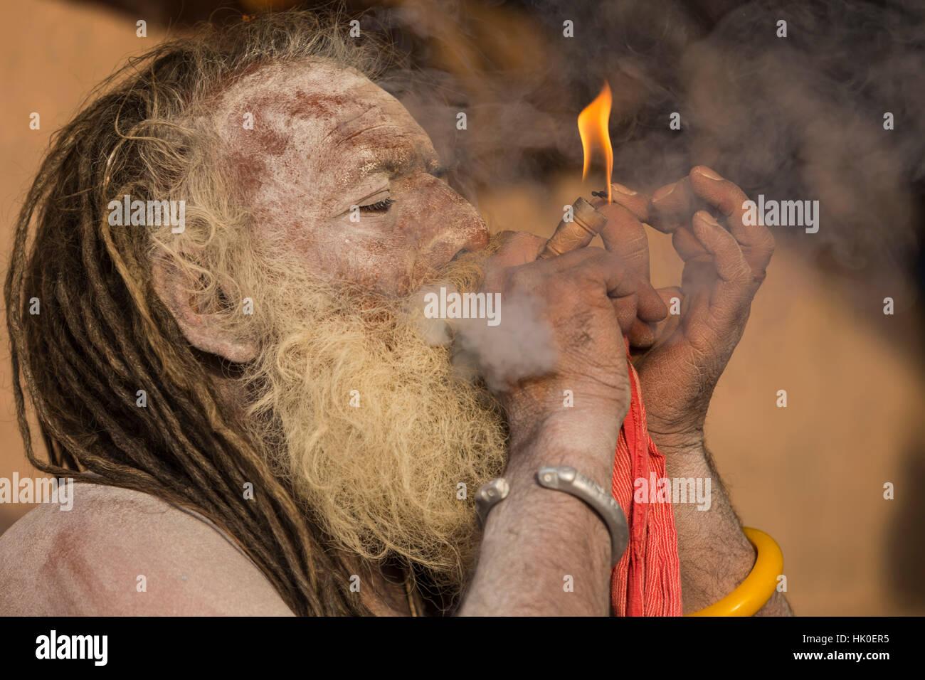 Sadhu smoking. Varanasi, India - Stock Image
