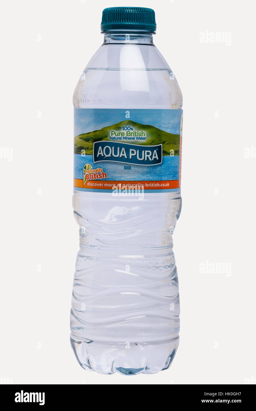A bottle of Aqua Pura mineral water on a white background - Stock Image
