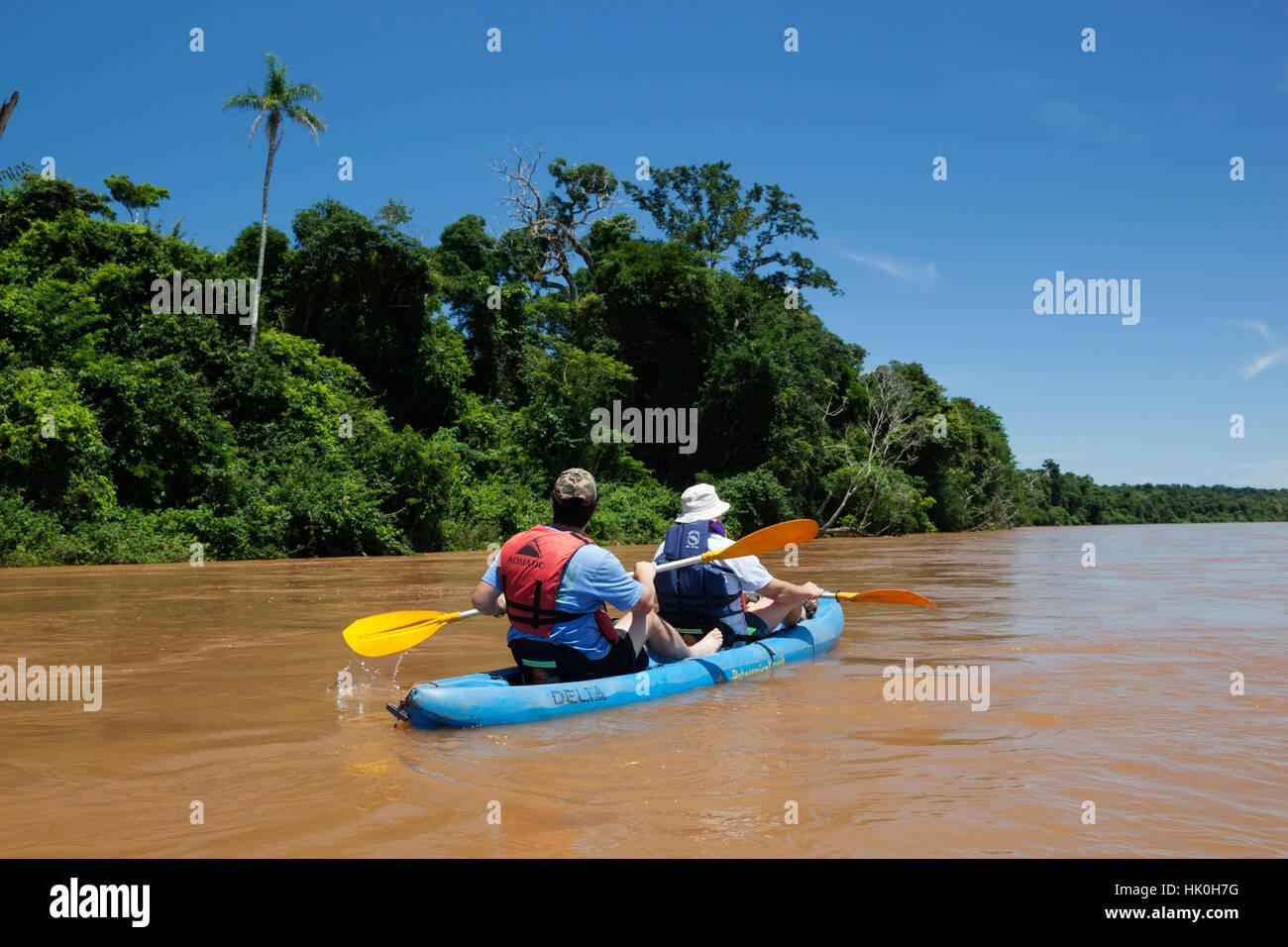 Kayaking on the Iguazu River past sub-tropical rainforest, near Andresito, Iguazu National Park, Misiones Province, - Stock Image