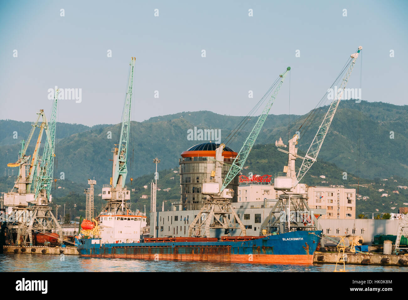 Old Barge Freight Ship Tanker In Port Dock On Sunny Evening At Sunset Or Sunrise Time In Batumi, Adjara, Georgia - Stock Image