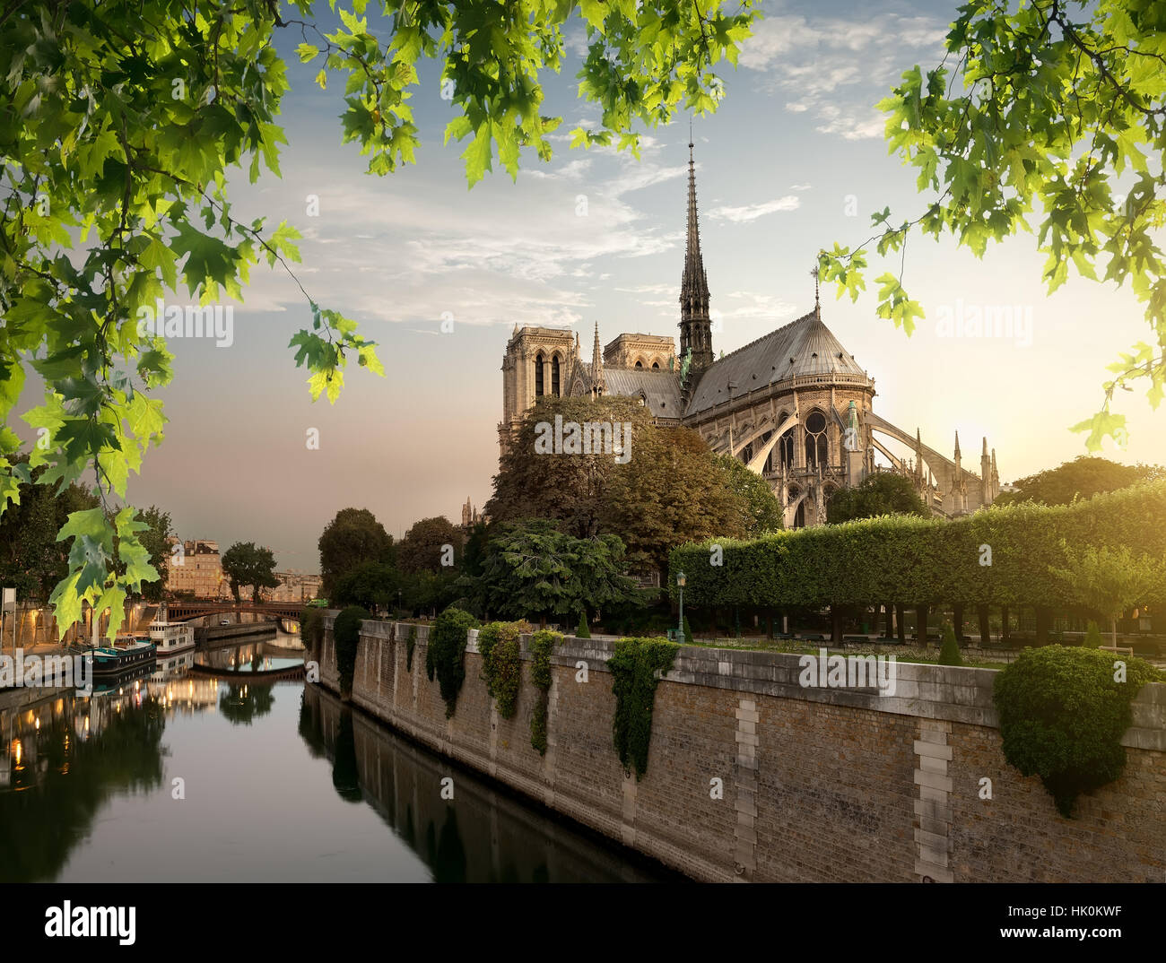 Notre Dame and park on river Seine in Paris, France - Stock Image