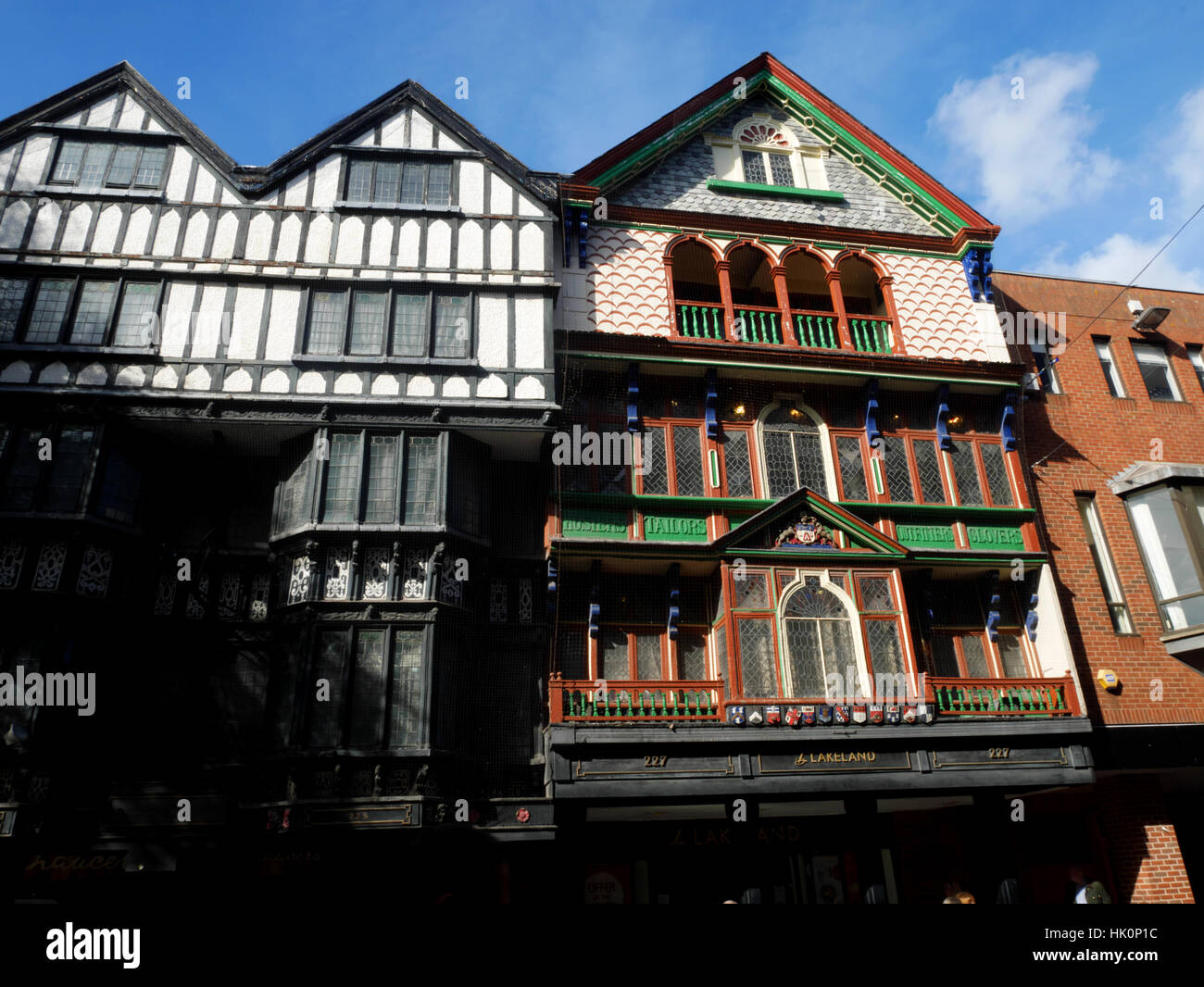 C17 Merchant's House, 226 High street, Exeter, Devon.  Tudor style front with old carved shop signs. - Stock Image