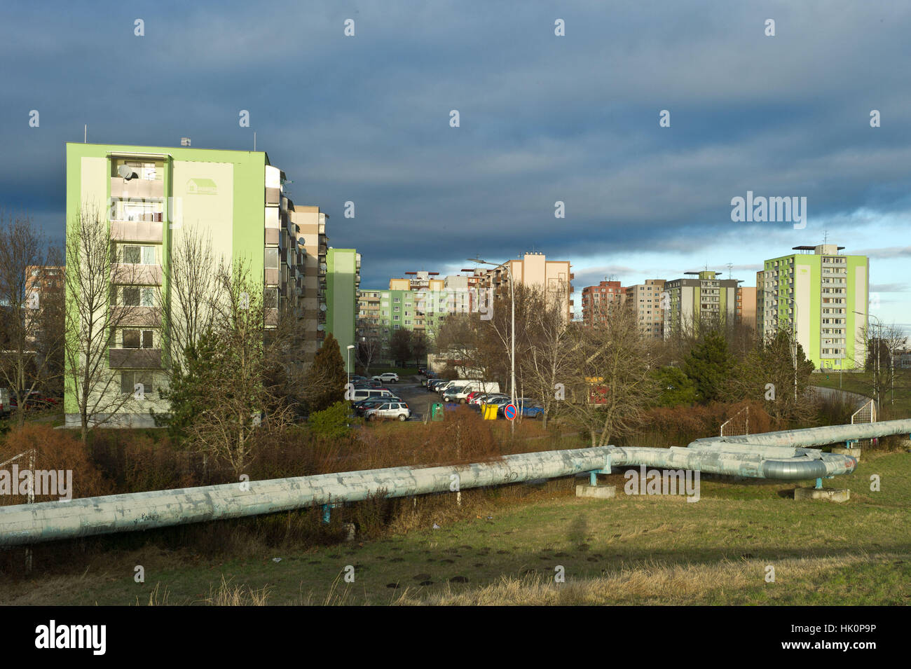 Blocks of appartments with district heating scheme pipework in forground. Nove Zamky Slovakia - Stock Image
