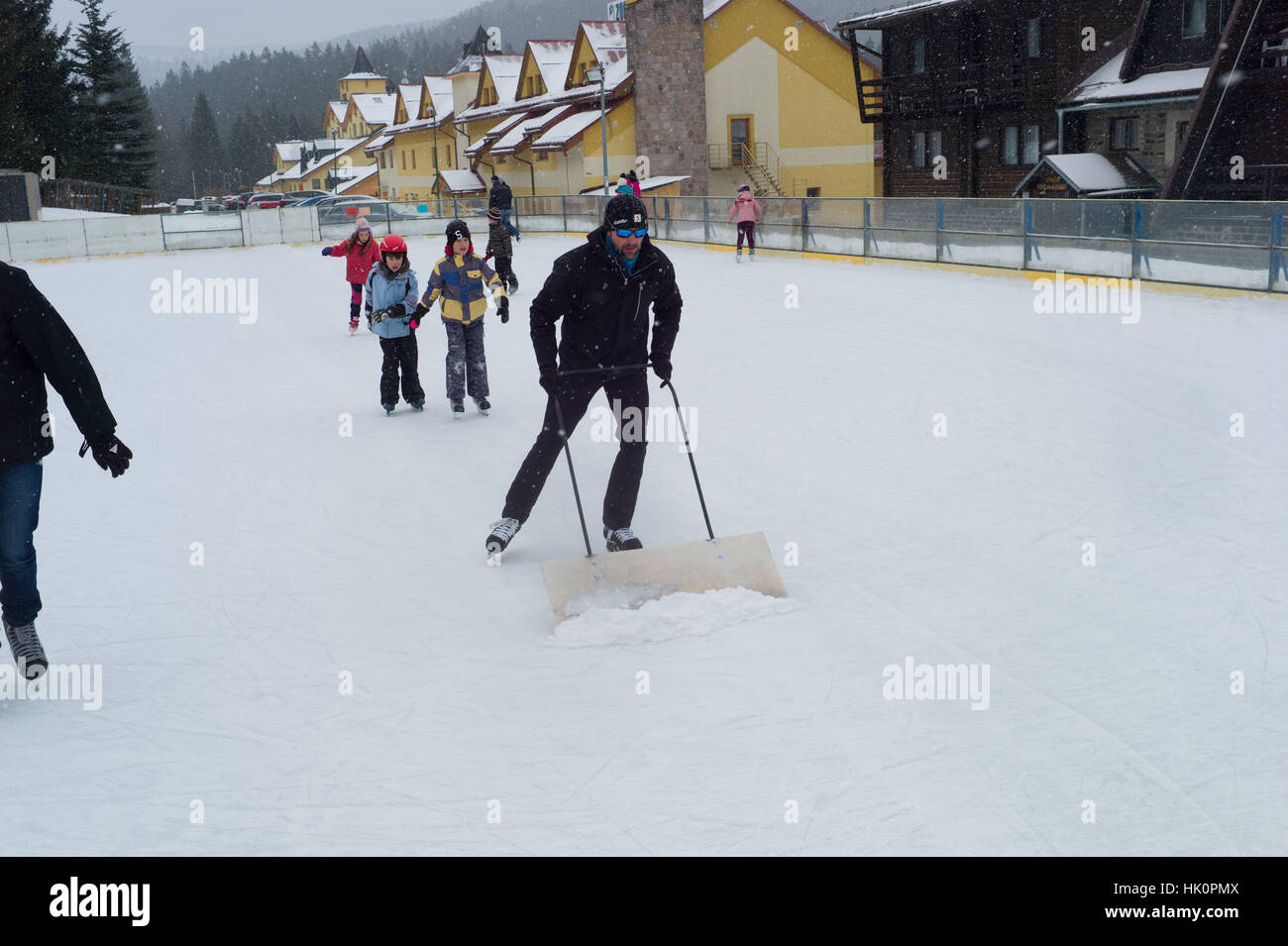 Clearing show from an outdoor ice skating rink in Donovaley, Nizke Tatry, Slovakia - Stock Image
