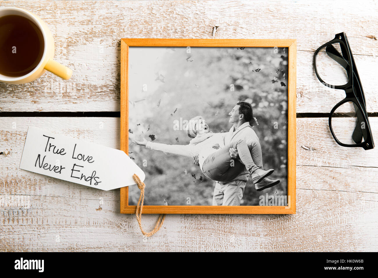 Black-and-white photo of senior couple in picture frame. Studio ...