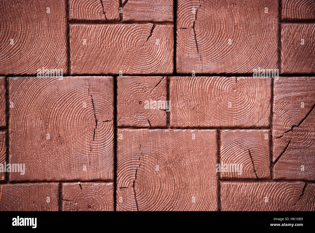 Different sizes of brown pavement tiles background - Stock Image