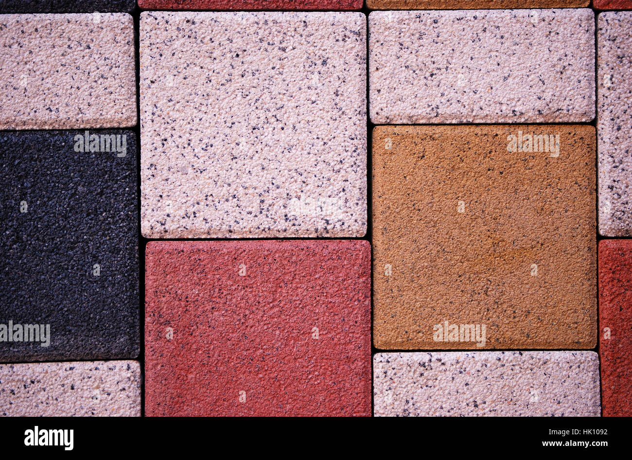 Different sizes of pavement tiles background - Stock Image