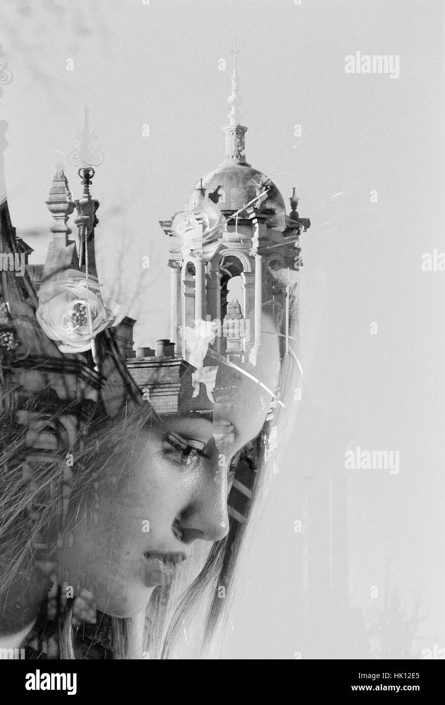 Double exposure; girl blending into building - Stock Image