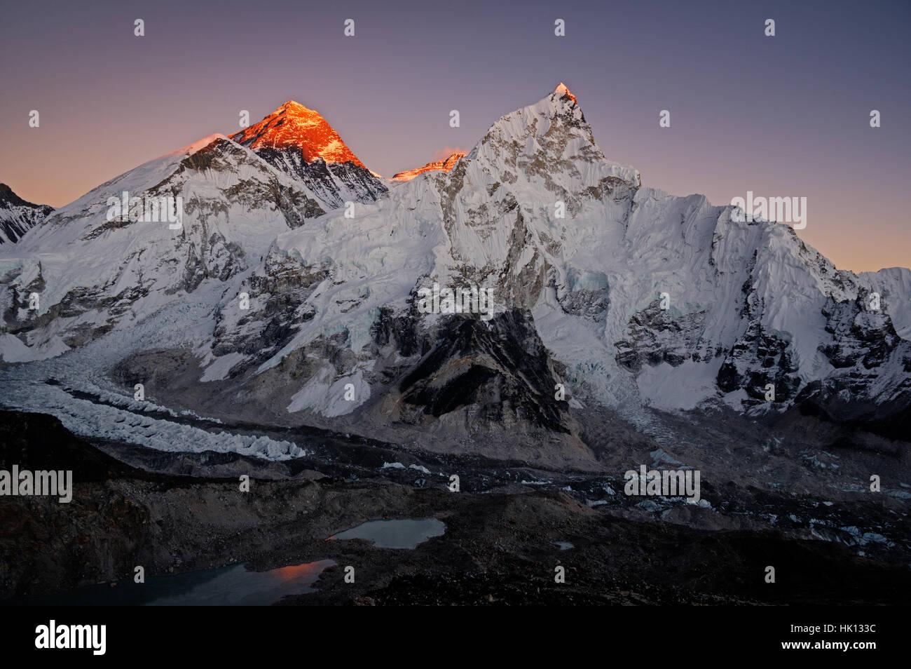 last light hitting the highest peaks of Everest, Lhotse, and Nuptse in Nepal from Kala Patthar - Stock Image