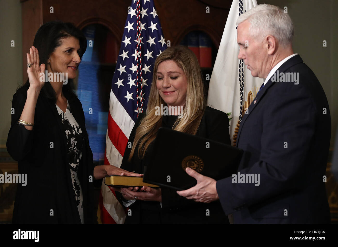 Washington DC, USA. 25th January 2017. United States Vice President Mike Pence swears in Nikki Haley (L) as the - Stock Image
