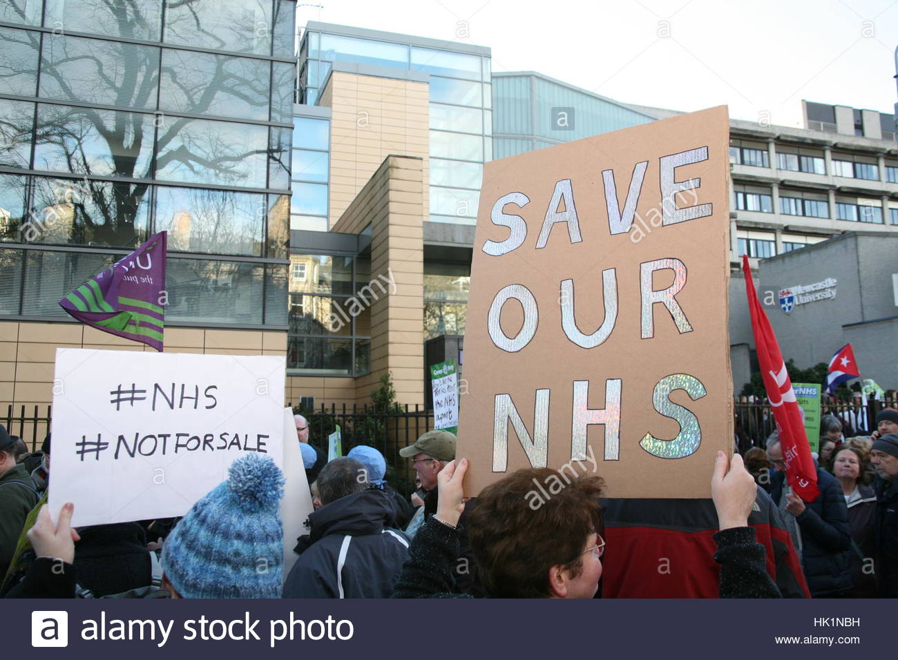 Newcastle, UK. 4th Feb, 2017. Protesters hold signs during a demonstration to defend National Health Service (NHS) - Stock Image