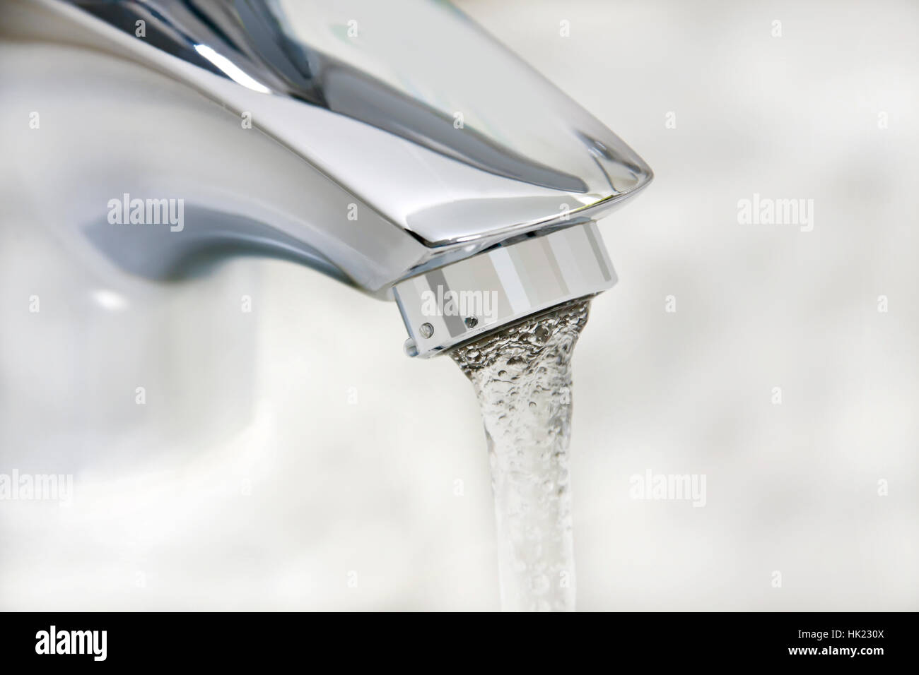 water running from an open faucet Stock Photo