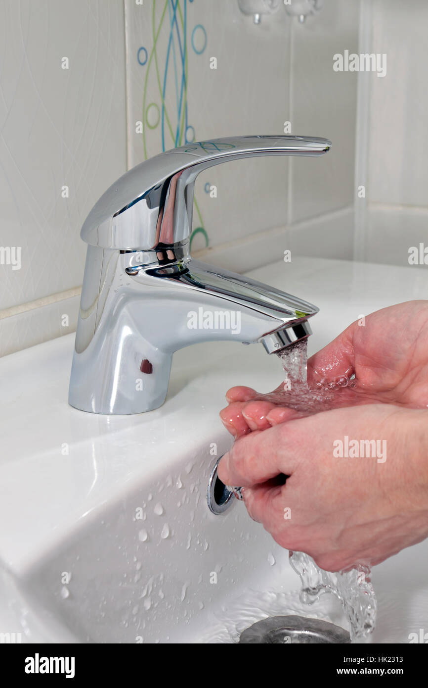 washing hands under a stream of water Stock Photo