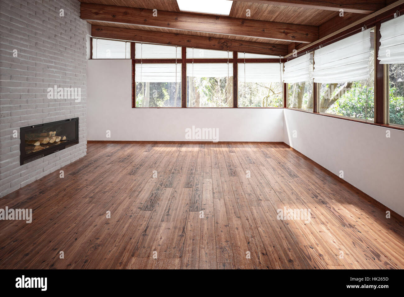 Empty room with panoramic windows, wooden floor and ceiling and modern minimalist fireplace. Architecture and interior Stock Photo