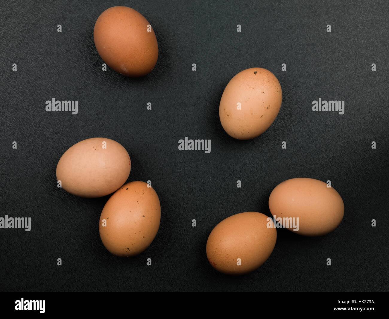 Six Fresh Uncooked Brown Hens Eggs - Stock Image