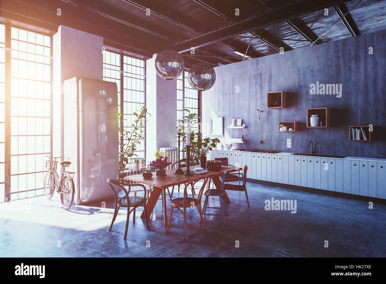 Interior of spacious modern apartment with dining table, chairs and bicycle leaning by tall windows with sun flare Stock Photo