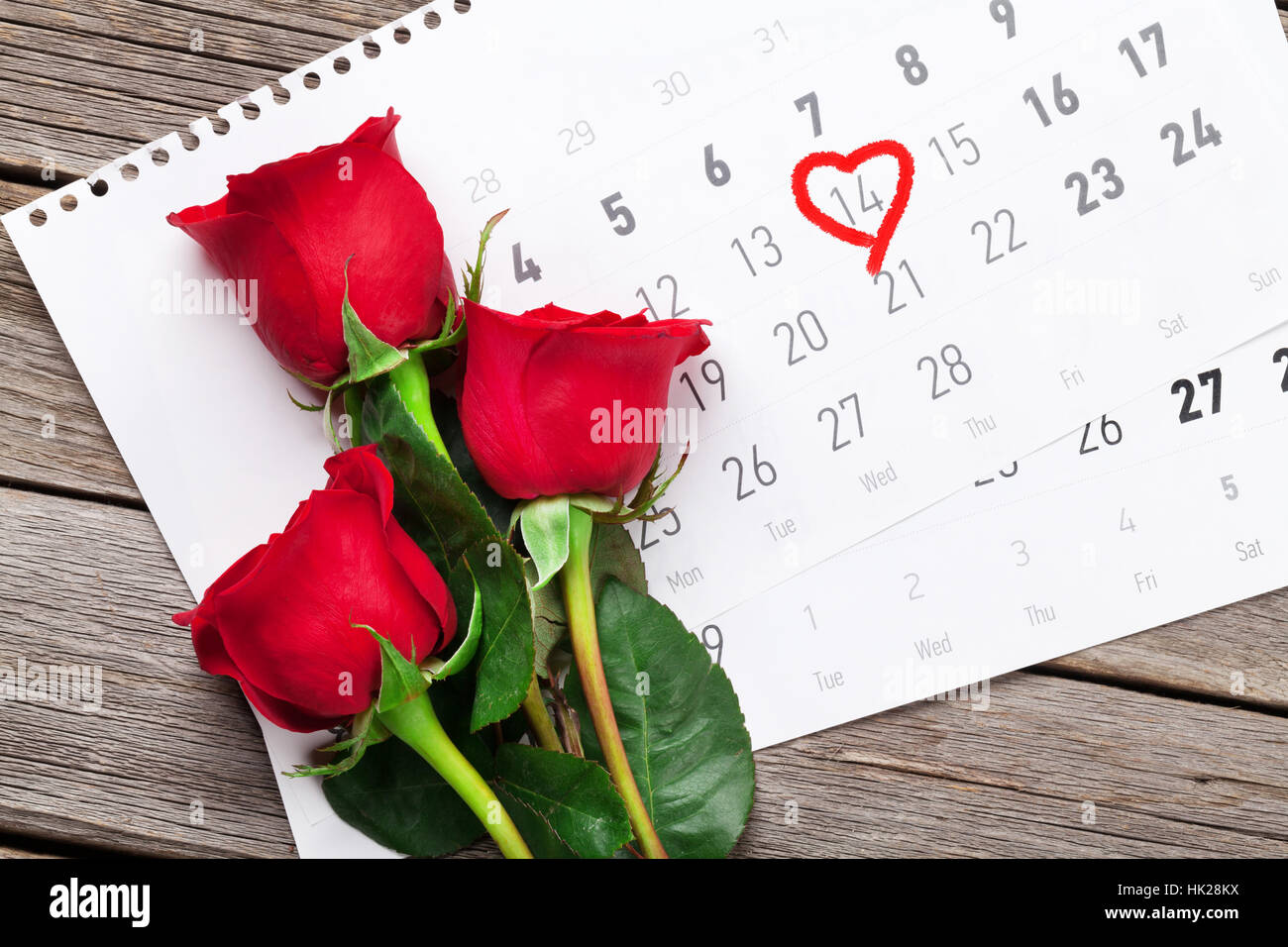Beautiful flowers icon over white stock photos beautiful flowers valentines day greeting card red rose flowers over february calendar on wooden table top izmirmasajfo