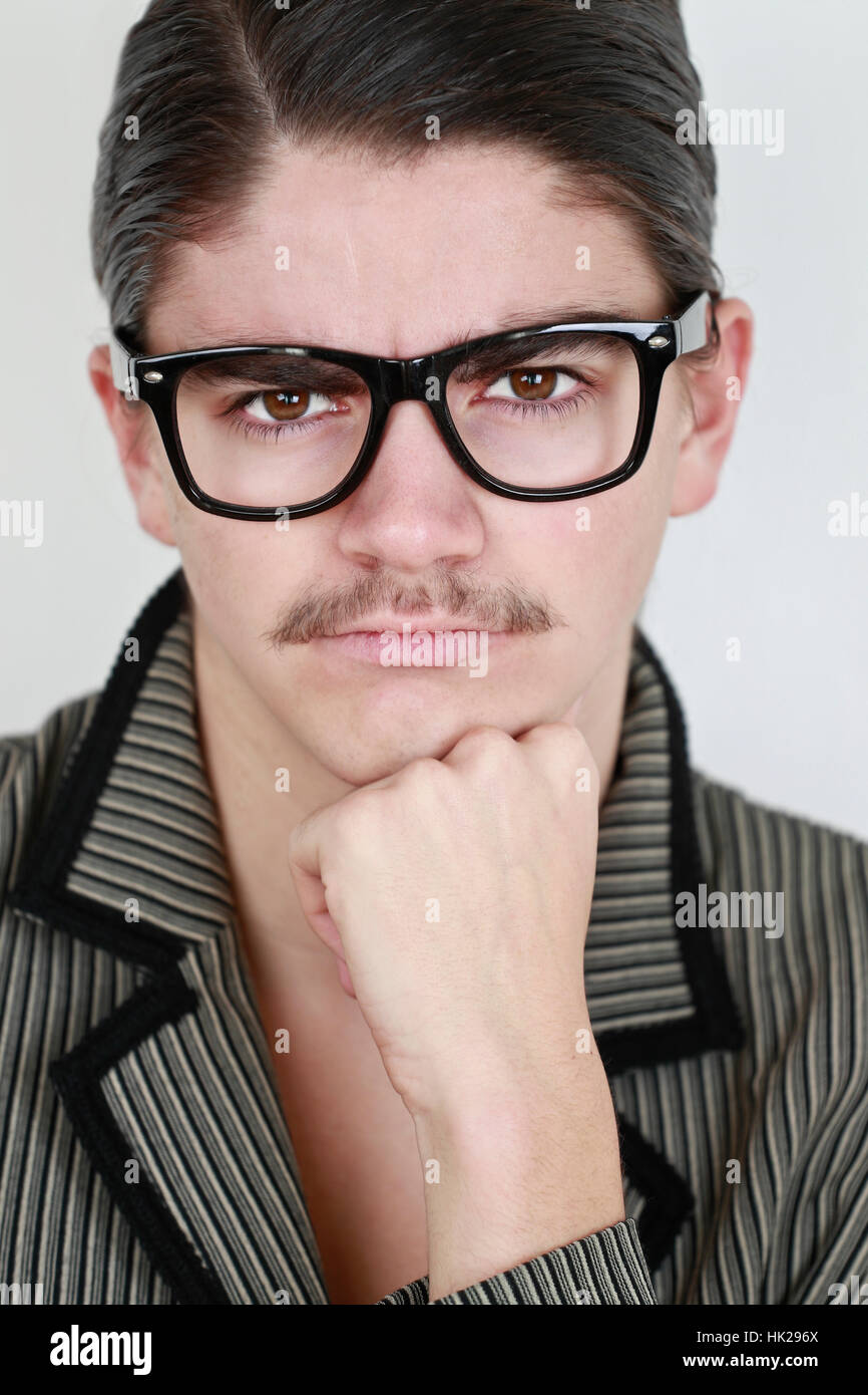 Portrait of young man wearing glasses - Stock Image