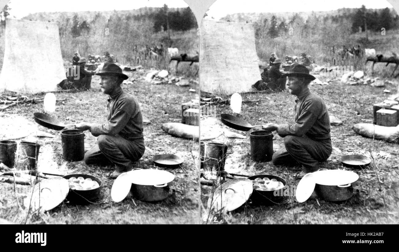 Stereograph of a USGS employee flipping a pancake at a field camp in the Rocky Mountains of Colorado. Image courtesy - Stock Image