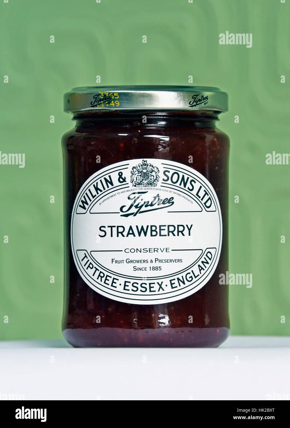 Jar of Wilkin & Sons Ltd., Tiptree Strawberry Conserve. - Stock Image