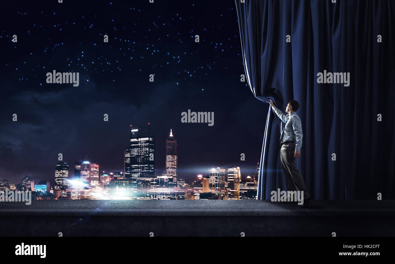 Night city behind curtain - Stock Image
