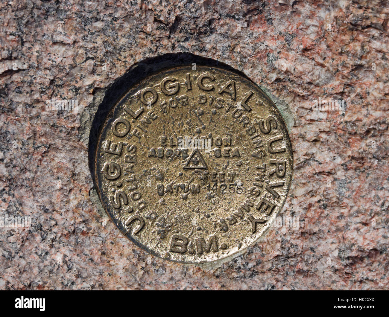Benchmark on the 14255 foot summit of Longs Peak in Rocky Mountain National Park - Stock Image