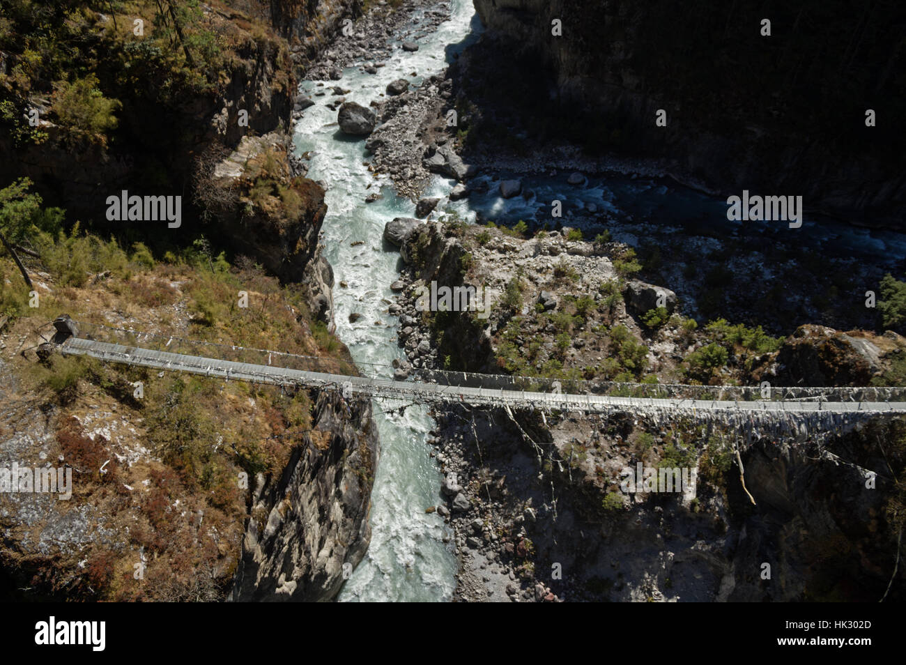 the old Larche Dibhan bridge over the Dudh Khosi River on the trek up to Namche Bazar in Nepal - Stock Image