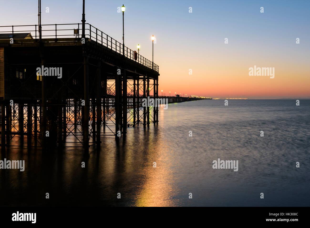 Sunrise under the pier - Stock Image