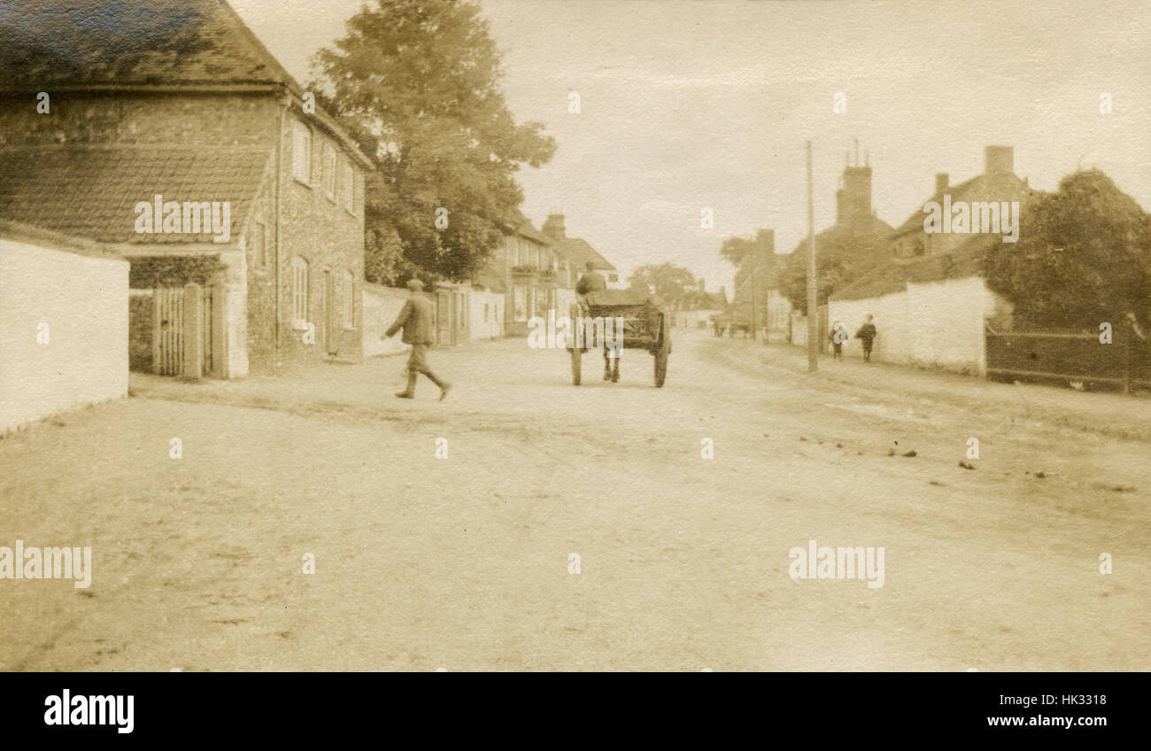 Antique July 1908 photograph, street with pedestrians in Lakenheath, Suffolk, England. - Stock Image