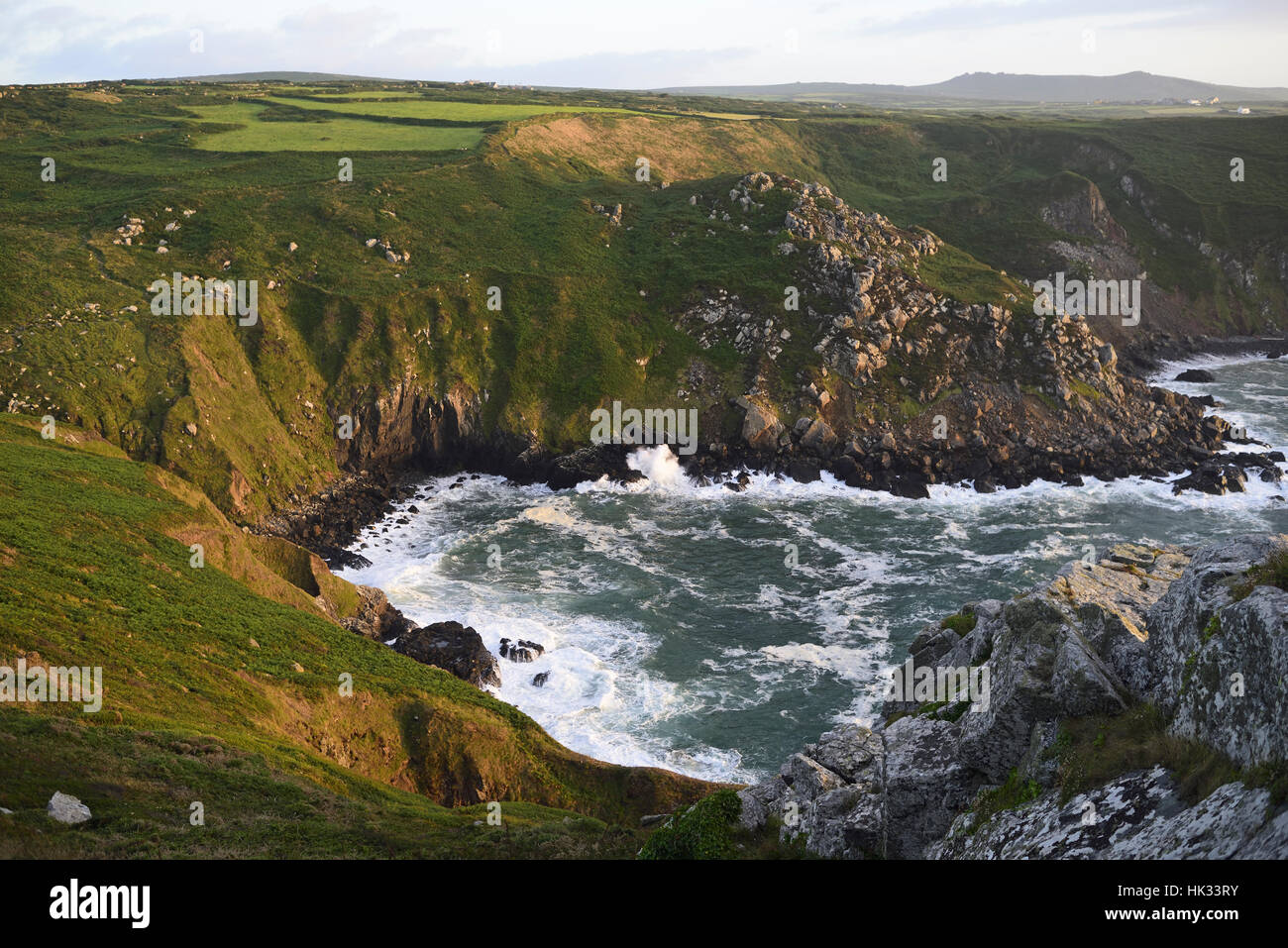 Looking over Pendour Cove from Zennor Head, Cornwall, showing cliffs and sea with spume from wind - Stock Image